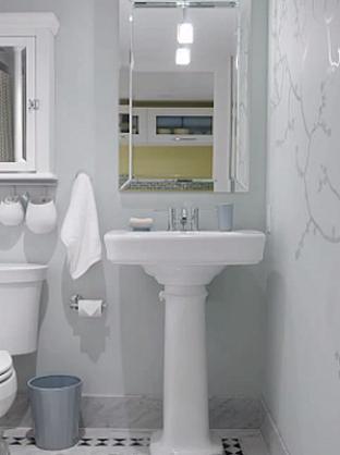 Bathroom showcasing white sink and single pendant light.