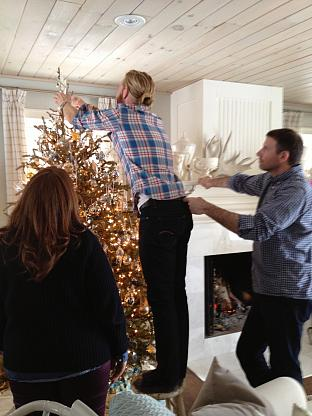 Photographer Bjorn Wallender and his assistant David Englehardt putting the star on the tree.