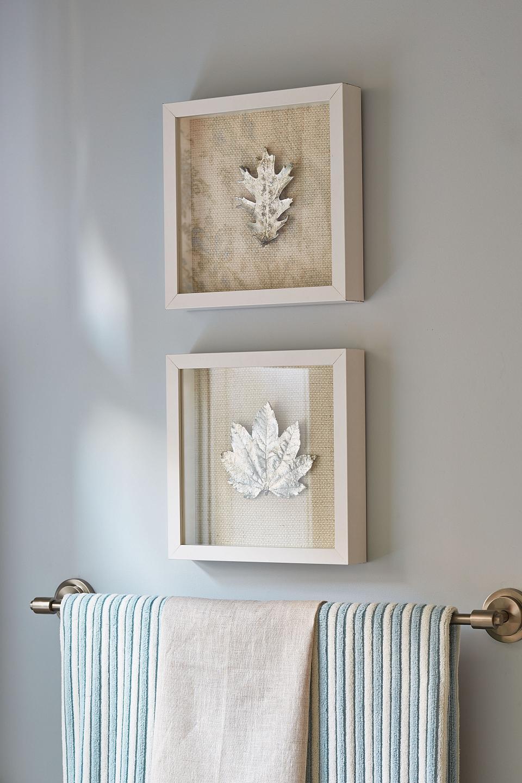 two frames above towel hanger