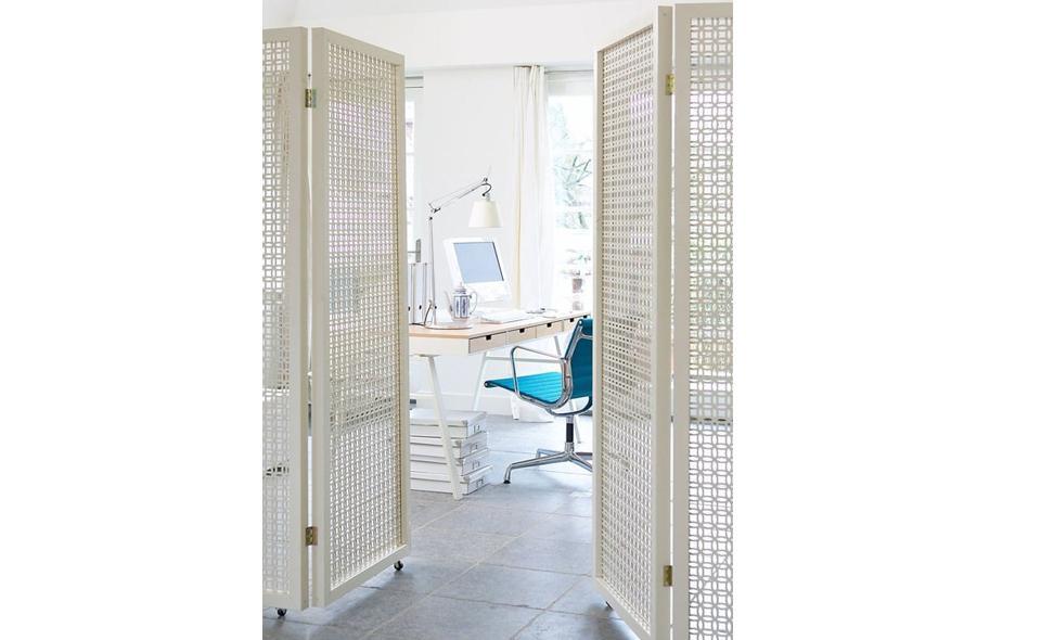 desk behind folding screen