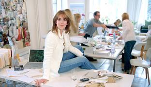 Room Service - Sarah sits on desk, team in background gathering inspiration